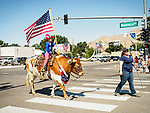 Longhorn steer with US Flag, Independence Day celebration on Winnemucca Boulevard for July 4th during the Silver State International Rodeo, Winnemucca, Nev.