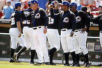 May 23, 2009:  Manager Ken Oberkfell, Hitting Coach Luis Natera, and Pitching Coach Ricky Bones of the Buffalo Bisons, International League Triple-A affiliate of the New York Mets, congratulates players after winning a game at Coca-Cola Field in Buffalo, NY.  Photo by:  Mike Janes/Four Seam Images