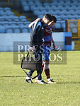 Drogheda United captain Sean Brennan is helped off the pitch. Photo:Colin Bell/pressphotos.ie