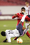 13 March 2008: Freddy Adu (USA) (11) tumbles after being tripped by Manuel Bonilla (PAN) (behind).  Bonilla received a yellow card for the foul. The United States U-23 Men's National Team defeated the Panama U-23 Men's National Team 1-0 at Raymond James Stadium in Tampa, FL in a Group A game during the 2008 CONCACAF's Men's Olympic Qualifying Tournament.