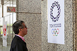 A man looks at the Tokyo 2020 Olympic Games logo on display at the Tokyo Metropolitan building on April 27, 2016, Tokyo, Japan. After scraping the original design last year due to accusations of plagiarism; The Tokyo 2020 Logo Selection Committee settled this week on a simple indigo-and-white checkered circle design by Asao Tokolo as a new emblem for the 2020 Summer Olympic Games. The final decision was announced on Monday 25th April after the selection committee had checked through almost 15,000 design proposals. The new logos are already starting to appear on Tokyo 2020 related communications. (Photo by Rodrigo Reyes Marin/AFLO)