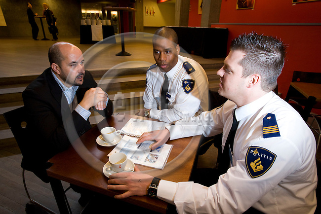 AMSTERDAM - NETHERLANDS - 06 MARCH 2008 -- From left  Ahmed MARCOUCH, mayor of the Amsterdam district of Slotervaart, speaking with Alfred C. van DIJK and D. HOUKES, both police officers at the Dutch police force. Photo: Erik Luntang/EUP-IMAGES