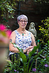 © Joel Goodman - 07973 332324 . 13/08/2017 . Salford , UK . Joy Watson (59) pictured in her garden in Eccles . Joy has Alzheimer's disease and has had to quit her job as a carer . As a campaigner and educator on the needs of people with dementia , she was praised by former Prime Minister David Cameron , who awarded her a Points of Light Award . But she and her retired husband and full-time carer, Tony, say they now struggle to pay their bills after an assessment by the DWP saw all their financial support withdrawn . For more information see http://www.mirror.co.uk/news/uk-news/woman-dementia-praised-david-cameron-10983661 . Photo credit : Joel Goodman