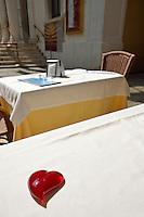 Glass hearshape on a restaurant table, Venice, Italy