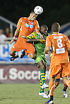 22 September 2012: Carolina's John Krause (PUR) (left) heads the ball over Tampa Bay's Carl Cort (25). The Carolina RailHawks played the Tampa Bay Rowdies to a 0-0 tie at WakeMed Soccer Stadium in Cary, NC in a 2012 North American Soccer League (NASL) regular season game.