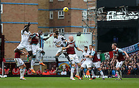 Pictured L-R: Battle for a header between Wilfried Bony of Swansea, Guy Demel of West Ham, Chico Flores of Swansea and James Collins of West Ham.  01 February 2014<br />