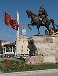 Tirana/Tirane-Albania - August 01, 2004---Seen from Skenderberg/Skanderberg Square: Clock tower (built in 1830), Minaret and the Mosque of Ethem Mey (built in 1793), National Albanian Flag and Statue, in the center of Tirana, capital city of Albania; culture-religion---Photo: © HorstWagner.eu