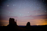 Stars from a moonless and little-polluted midnight sky shine over the distinctive buttes at Monument Valley Navajo Tribal Park in southern Utah. The park, operated by teh tribe, was once a popular set for western films of the 1930s through 60s. It is immensely popular among European tourists. (Kevin Moloney for the New York Times)
