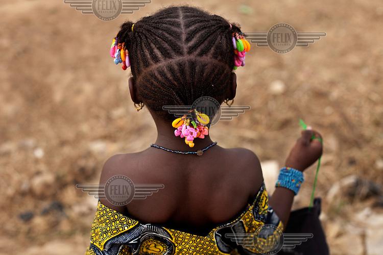A girl outside Megetana Sirakoro school on the outskirts of Bamako.
