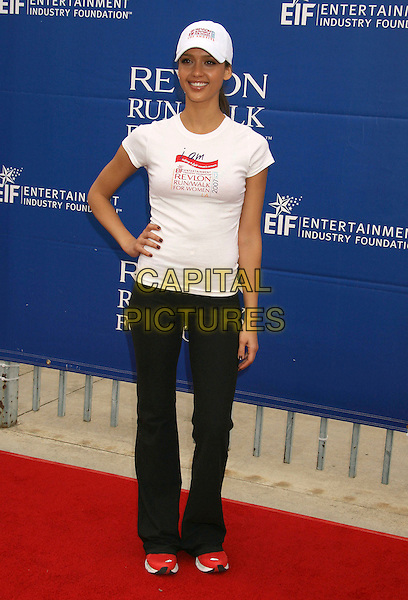 JESSICA ALBA.14th Annual Entertainment Industry Foundation Revlon Run/Walk For Women held at The Los Angeles Memorial Coliseum, Los Angeles, California, USA,.12 May 2007..full length cap hat white t-shirt black jogging tracksuit trousers bottoms red trainers sporty hand on hip.CAP/ADM/RE.©Russ Elliot/AdMedia/Capital Pictures.