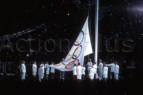 15.09.2000. Olympic Stadium, Sydney, Australia. The Olympic Flag is raised by officials at the Opening Ceremony, Olympic Games, Sydney