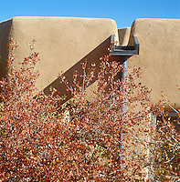 A detail showing the flat roof of a contemporary adobe house in New Mexico highlighting the traditional methods of construction