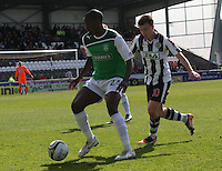 Isaiah Osbourne being watched by Paul McGowan in the St Mirren v Hibernian Clydesdale Bank Scottish Premier League match played at St Mirren Park, Paisley on 29.4.12.