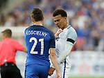 France's Laurent Koscielny tussles with England's Dele Alli during the Friendly match at Stade De France Stadium, Paris Picture date 13th June 2017. Picture credit should read: David Klein/Sportimage