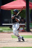 GCL Marlins shortstop Osiris Johnson (9) follows through on a swing during a game against the GCL Astros on August 5, 2018 at FITTEAM Ballpark of the Palm Beaches in West Palm Beach, Florida.  GCL Astros defeated GCL Marlins 2-1.  (Mike Janes/Four Seam Images)