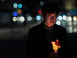 "Baek Seunghoon, a member of the Methodist Church, holds a candle during a December 7, 2017 nighttime vigil in Gwangwha-Mun Square in Seoul, South Korea. The ecumenical Advent vigil was part of ""A Light of Peace Campaign"" for the denuclearization of the Korean Peninsula, sponsored by the World Council of Churches and the National Council of Churches of Korea."