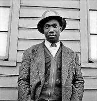 A Black shipyard worker who helps build Liberty Ships at the Bethlehem-Fairfield shipyards, Baltimore, Maryland. May 1943.<br /> <br /> Photo by Arthur S. Siegel.