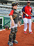16 May 2012: Washington Nationals first baseman Adam LaRoche's son Drake LaRoche wears his Little League catching gear during team batting practice prior to a game against the Pittsburgh Pirates at Nationals Park in Washington, DC. Adam notched his 1000th career hit and was named Player of the Game as the Nationals defeated the Pirates 7-4 in the first game of their 2-game series. Mandatory Credit: Ed Wolfstein Photo