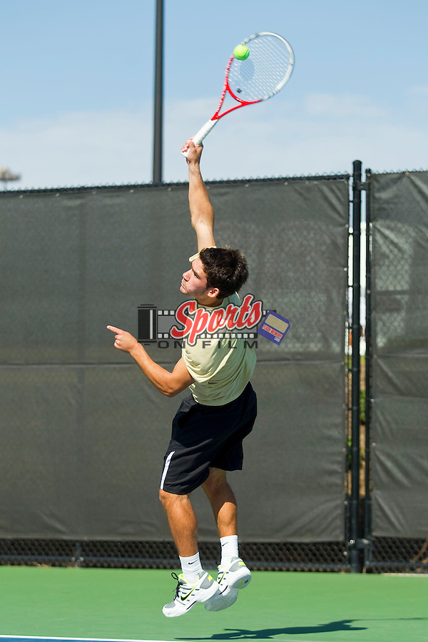 Anthony Delcore of the Wake Forest Demon Deacons serves the ball at the Wake Forest Tennis Center on October 12, 2012 in Winston-Salem, North Carolina.  (Brian Westerholt/Sports On Film)