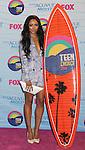 UNIVERSAL CITY, CA - JULY 22: Kat Graham poses in the press room at the 2012 Teen Choice Awards at Gibson Amphitheatre on July 22, 2012 in Universal City, California.