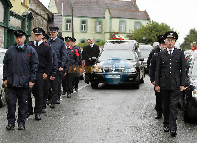 Firemen from Monaghan, Dundalk and Crossmaglen in Norther Ireland flank the remains of Siobhan McConnon and Anthony Holland who were killed in a car crash near Mullingar on Friday last. They were buried in St. Jospeh's cemetery in Carrickmacross yesterday..Photo Fran Caffrey Newsfile.ie..This Picture has been sent to you by Newsfile Ltd..The Studio,.Millmount Abbey,.Drogheda,.Co. Meath,.Ireland..Tel: +353(0)41-9871240.Fax: +353(0)41-9871260.ISDN: +353(0)41-9871010.www.newsfile.ie..general email: pictures@newsfile.ie