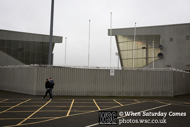 St Mirren 4 The New Saints 1, 19/02/2017. Paisley 2021 Stadium, Scottish Challenge Cup. Two supporters walking round the Paisley2021 Stadium before Scottish Championship side St Mirren played Welsh champions The New Saints in the semi-final of the Scottish Challenge Cup for the right to meet Dundee United in the final. The competition was expanded for the 2016-17 season to include four clubs from Wales and Northern Ireland as well as Scottish Premier under-20 teams. Despite trailing at half-time, St Mirren won the match 4-1 watched by a crowd of 2044, including 75 away fans. Photo by Colin McPherson.