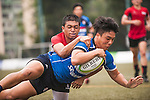 Junhwa Kim (r) of South Korea fights for the ball with Mark Anthony of Singapore during the match between South Korea and Singapore of the Asia Rugby U20 Sevens Series 2016 on 12 August 2016 at the King's Park, in Hong Kong, China. Photo by Marcio Machado / Power Sport Images