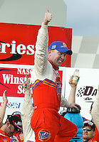 Ricky Craven celebrates in victory lane after winning the Carolina Dodeg Dealers 400 NASCAR WInston Cup race at Darlington Raceway, Darlington, SC, March 16, 2003.  (Photo by Brian Cleary/www.bcpix.com)