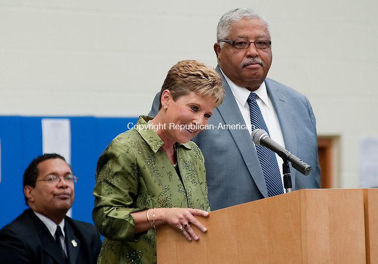 WATERBURY, CT- 30 SEPTEMBER 2012-093012JS09-  Kathleen M. Ouellette Superintendent of Schools for the City of Waterbury and former Superintendent David L. Snead, speak to guests during the dedication of the Jonathan E. Reed School in Waterbury on Sunday. .Jim Shannon Republican-American..