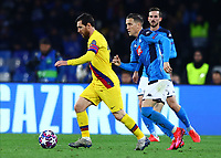 25th February 2020; Stadio San Paolo, Naples, Campania, Italy; UEFA Champions League Football, Napoli versus Barcelona; Lionel Messi of Barcelona holds off Piotr Zielinski of Napoli