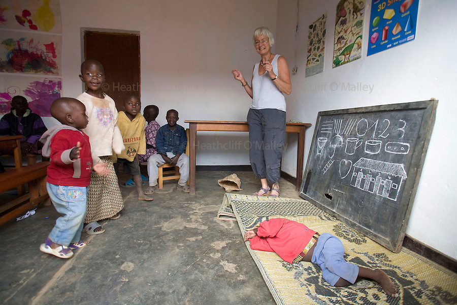 May0016089 . Daily Telegraph..Features.. Sally Chaplin taking a class of children at the Ngwino Nawe (Come To Us) Children's Village built by Rwanda Aid a british charity and recipient of funds from the Daily Telegraph's 2005 Christmas appeal..Built in Ntendezi in south west Rwanda, the village acts as both home and school for orphans, some victims of the 1994 genocide, and the mentally and physically handicapped...Rwanda 28 August 2009