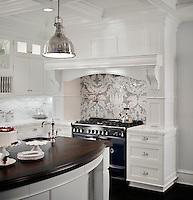 This custom kitchen features a handmade Kingston Lacy backsplash, shown in Calacatta Tia and Bardiglio is by Rogers & Goffigon.<br />