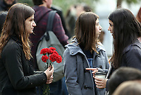 Pictured: Young women with red carnations at the Athens Polytechinc in Athens Greece. Wednesday 16 November 2016<br /> Re: 43rd anniversary of the Athens Polytechnic uprising of 1973 which was a massive demonstration of popular rejection of the Greek military junta of 1967–1974. The uprising began on November 14, 1973, escalated to an open anti-junta revolt and ended in bloodshed in the early morning of November 17 after a series of events starting with a tank crashing through the gates of the Polytechnic.
