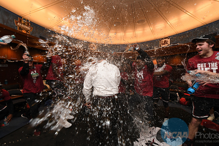NEW YORK, NY - MARCH 26:  Head coach Frank Martin of the the South Carolina Gamecocks celebrates in the locker room after winning the East Regional against the University of Florida during the 2017 NCAA Men's Basketball Tournament held at Madison Square Garden on March 26, 2017 in New York City. (Photo by Justin Tafoya/NCAA Photos via Getty Images)