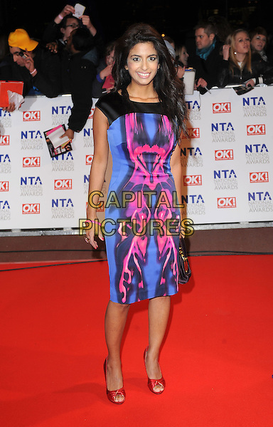 KONNIE HUQ.Arrivals at the 15th National Television Awards held at the O2 Arena, London, England. .January 20th, 2010 .NTA NTAs full length blue black pink pattern print dress.CAP/BEL.©Tom Belcher/Capital Pictures