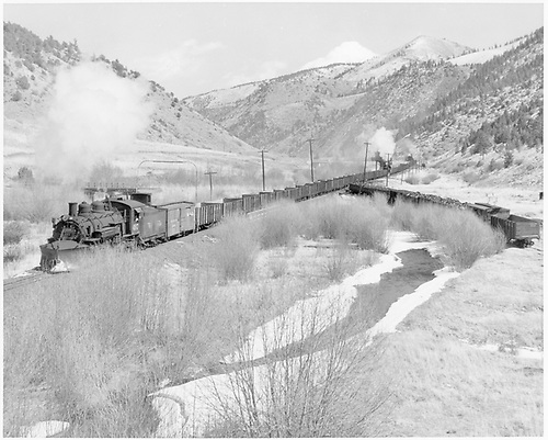 D&amp;RGW #497 leads a westbound three-engine train of empty gondolas at Mears Junction.  Just passing under the telltale for the bridge.<br /> D&amp;RGW  Mears Junction, CO  Taken by Richardson, Robert W. - 5/23/1950
