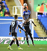 30th September 2017, Madejski Stadium, Reading, England; EFL Championship football, Reading versus Norwich City; Liam Moore of Reading climbs on Cameron Jerome of Norwich City to head the ball