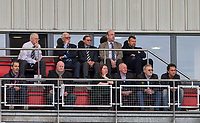 Wycombe Wanderers Chairman Andrew Howard (top right) sits with other Staff & directors of Wycombe trust during the Sky Bet League 2 match between Leyton Orient and Wycombe Wanderers at the Matchroom Stadium, London, England on 1 April 2017. Photo by Andy Rowland.