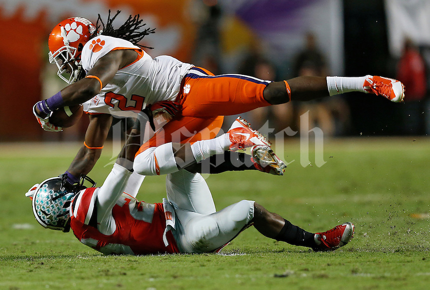 Ohio State Buckeyes cornerback Armani Reeves (26) takes down Clemson Tigers wide receiver Sammy Watkins (2) in the second quarter of the Discover Orange Bowl between Ohio State and Clemson at Sun Life Stadium in Miami Gardens, Florida, Friday night, January 3, 2014. As of half time the Ohio State Buckeyes led the Clemson Tigers 22 - 20.(The Columbus Dispatch / Eamon Queeney)