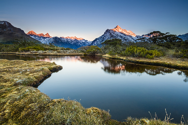 Sunrise on Mt Christina and the Darran Mountains. From the tarns at Key Summit, Routeburn Track.<br /> <br /> Fiordland  National Park, South Island, New Zealand.