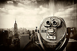 FEB. 27, 2011 - Manhattan, New York, U.S. - Binoculars closeup at Observation Deck of Top of the Rock, 30 Rockefeller Center with Manhattan view including Empire State Building. antique sepia