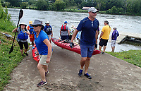 NWA Democrat-Gazette/FLIP PUTTHOFF <br />The volunteer spirit is a big part of the trip. Paddlers help each other get their boats in and out of the water each day. Everyone who organizes and leads the trip is a volunteer. Here paddlers help each other get boats out of the water July 31 2018 on the Des Moines River.