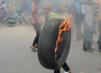 Pictured: Congress activists throw burning tyres.<br />  Re: Activists of the Congress political party clash with police in protest against price rises in oil, gas and other daily commmodities by BJP government in Agartala, in the Tripura area of India. Monday 10 September 2018