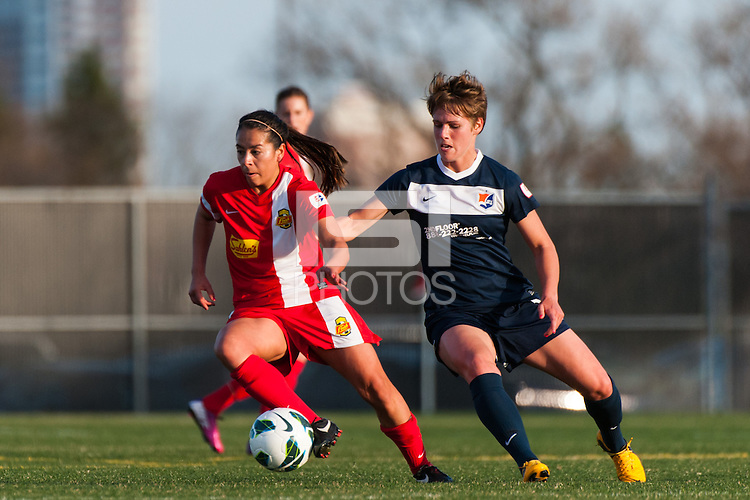 Western New York Flash midfielder Veronica Perez (17) is marked by Sky Blue FC midfielder Sophie Schmidt (16). Sky Blue FC defeated the Western New York Flash 1-0 during a National Women's Soccer League (NWSL) match at Yurcak Field in Piscataway, NJ, on April 14, 2013.