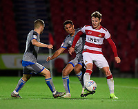 Lincoln City's Jack Payne, left, and Lincoln City's Max Melbourne vie for possession with Doncaster Rovers' Kieran Sadlier<br /> <br /> Photographer Chris Vaughan/CameraSport<br /> <br /> EFL Leasing.com Trophy - Northern Section - Group H - Doncaster Rovers v Lincoln City - Tuesday 3rd September 2019 - Keepmoat Stadium - Doncaster<br />  <br /> World Copyright © 2018 CameraSport. All rights reserved. 43 Linden Ave. Countesthorpe. Leicester. England. LE8 5PG - Tel: +44 (0) 116 277 4147 - admin@camerasport.com - www.camerasport.com