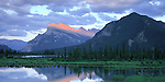 Banff National Park, Canada     Mount Rundle and breaking cloud cover reflecting on Vermillion Lake