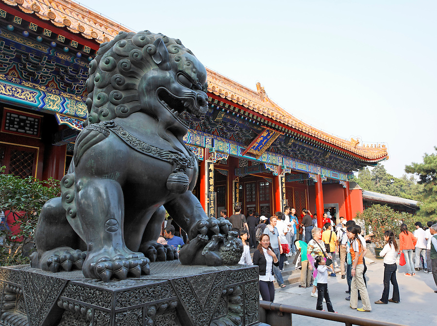 Lion guarding Paiyun Gate (Cloud-Dispelling Gate), Summer Palace, Beijing, China, Asia