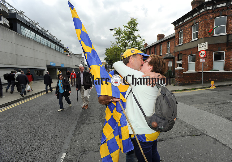 Michael and Monica Lenihan of O Callaghan's Mills celebrating their 30th wedding anniversary in style on Jones Road before the All-Ireland senior hurling final against Cork at Croke Park. Photograph by John Kelly.