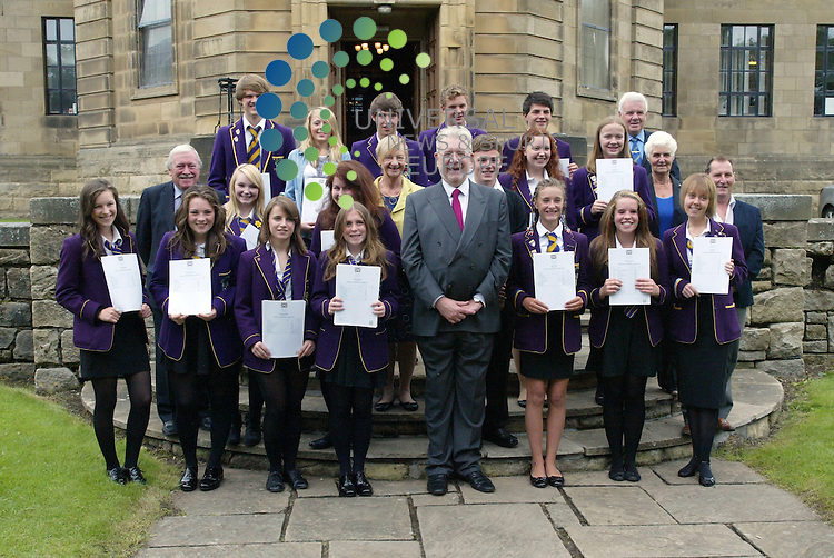 Mike Russell along with the pupils and local councilors on the steps of the forecourt of Troon's Marr College  with their Higher results. 07/08/2012 Picture: Universal News and Sport (Scotland)