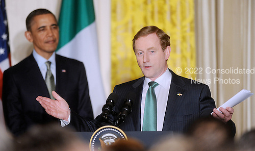 Prime Minister Enda Kenny of Ireland speaks alongside United States President Barack Obama during a St. Patrick's Day reception in the East Room of the White House in Washington, DC, March 17, 2011. .Credit: Olivier Douliery / Pool via CNP
